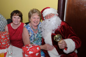 Santa with Cora Smith and Maura Lynch at the Clontibret Social Club Christmas Party. ©Rory Geary/The Northern Standard