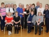 Some of the members of the Clontibret Social Club, are pictured making a presentation to Ann McEneaney, at their Christmas party, that was held at the Clontibret Community Centre. The presentation was made to Ann in appreciation of her work and dedication to the club.  In photo are front (L-R) Christine Rooney, Eilish Evans, Yvonne Creavon and Geraldine McSkeane. Behind (L-R) Helen McSkeane, Claire McGuigan, Eamon Rooney, Eileen Kearns, Kathleen McQuaid, Sean Mulligan, Kitty Greenan, Ann McEneaney, Patsy Evans, Marie McAdam, Peader Greenan, Dette Brennan and Denise Brennan. ©Rory Geary/The Northern Standard
