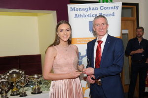 Alan Clarke, chairman of the Monaghan County Athletics Board, making the presentation to Niamh Malone, Monaghan Phoenix AC. ©Rory Geary/The Northern Standard