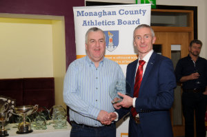 Paul O'Neill, left,Clones AC,  accepting the presentation on behalf of Denis Toner from Alan Clarke, chairman of the Monaghan County Athletics Board. ©Rory Geary/The Northern Standard