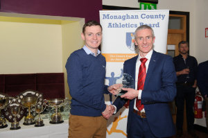 Alan Clarke, chairman of the Monaghan County Athletics Board, making the presentation to Conor Duffy, Glaslough Harriers. ©Rory Geary/The Northern Standard
