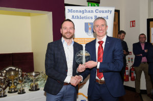 Ross Miotti, Monaghan Phoenix AC, being presented with his award by Alan Clarke, chairman of the Monaghan County Athletics Board. ©Rory Geary/The Northern Standard