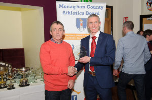 Noel Kennedy, left, Glaslough Harriers, accepting the award on behalf of Amy Hamill, from Alan Clarke, chairman of the Monaghan County Athletics Board. ©Rory Geary/The Northern Standard