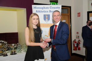 Alan Clarke, chairman of the Monaghan County Athletics Board, making the presentation to Ava Ross, Glaslough Harriers. ©Rory Geary/The Northern Standard