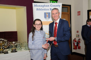 Alan Clarke, chairman of the Monaghan County Athletics Board, making the presentation to Amy Jo Kierans, Oriel AC. ©Rory Geary/The Northern Standard