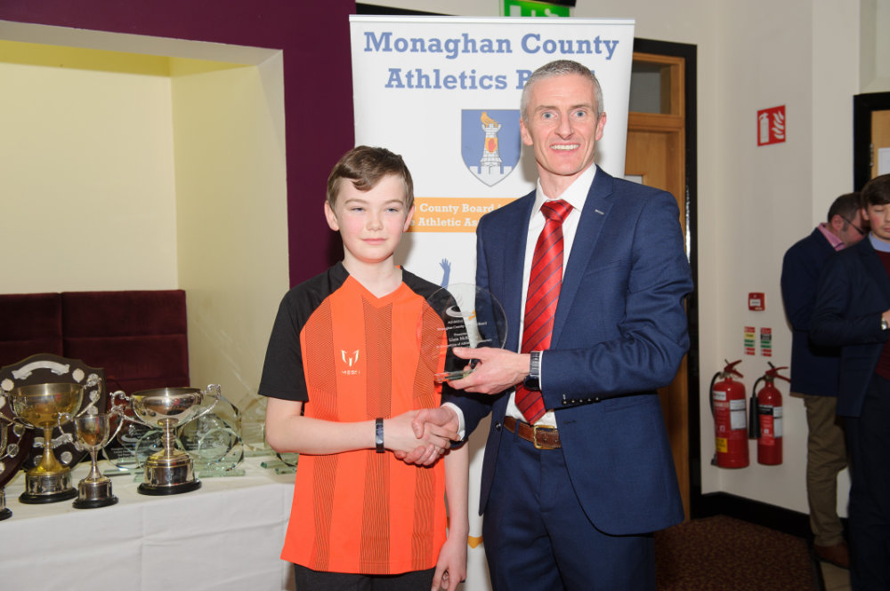 Alan Clarke, chairman of the Monaghan County Athletics Board, making the presentation to Jamie Laverty, Carrick Aces. ©Rory Geary/The Northern Standard
