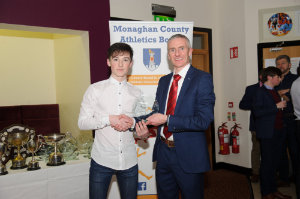 Conor Maguire, left, Monaghan Phoenix AC, accepting his award from Alan Clarke, chairman of the Monaghan County Athletics Board. ©Rory Geary/The Northern Standard