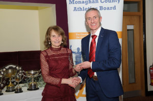 Rose Lambe, Carrick Aces, being presented with her award by Alan Clarke, chairman of the Monaghan County Athletics Board. ©Rory Geary/The Northern Standard