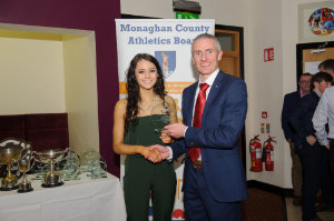Michaela O'Hanlon, Monaghan Phoenix AC, being presented with her award by Alan Clarke, chairman of the Monaghan County Athletics Board. ©Rory Geary/The Northern Standard