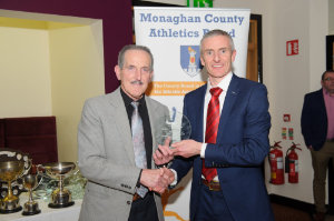 Anglo McNally, left, Monaghan Town Runners, being presented with his award by Alan Clarke, chairman of the Monaghan County Athletics Board. ©Rory Geary/The Northern Standard