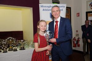Omey McArdle from Carrick Aces, being presented with her award by Alan Clarke, chairman of the Monaghan County Athletics Board. ©Rory Geary/The Northern Standard