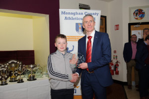Matthew Finn, Glaslough Harriers. being presented with his award by Alan Clarke, chairman of the Monaghan County Athletics Board. ©Rory Geary/The Northern Standard