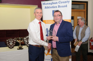 """Alan Clarke, chairman of the Monaghan County Athletics Board, left, making a presentation to Tommy Maguire, author of the book """"The Runner McGeough"""" who spoke at the Monaghan County Athletics Board Awards function in Concra Wood Golf Club, last weekend. ©Rory Geary/The Northern Standard"""