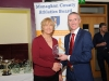 Alan Clarke, chairman of the Monaghan County Athletics Board, making the presentation to Una McMahon, Monaghan Phoenix AC. ©Rory Geary/The Northern Standard