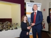Meave Smith, Carrick Aces, being presented with her award by Alan Clarke, chairman of the Monaghan County Athletics Board. ©Rory Geary/The Northern Standard
