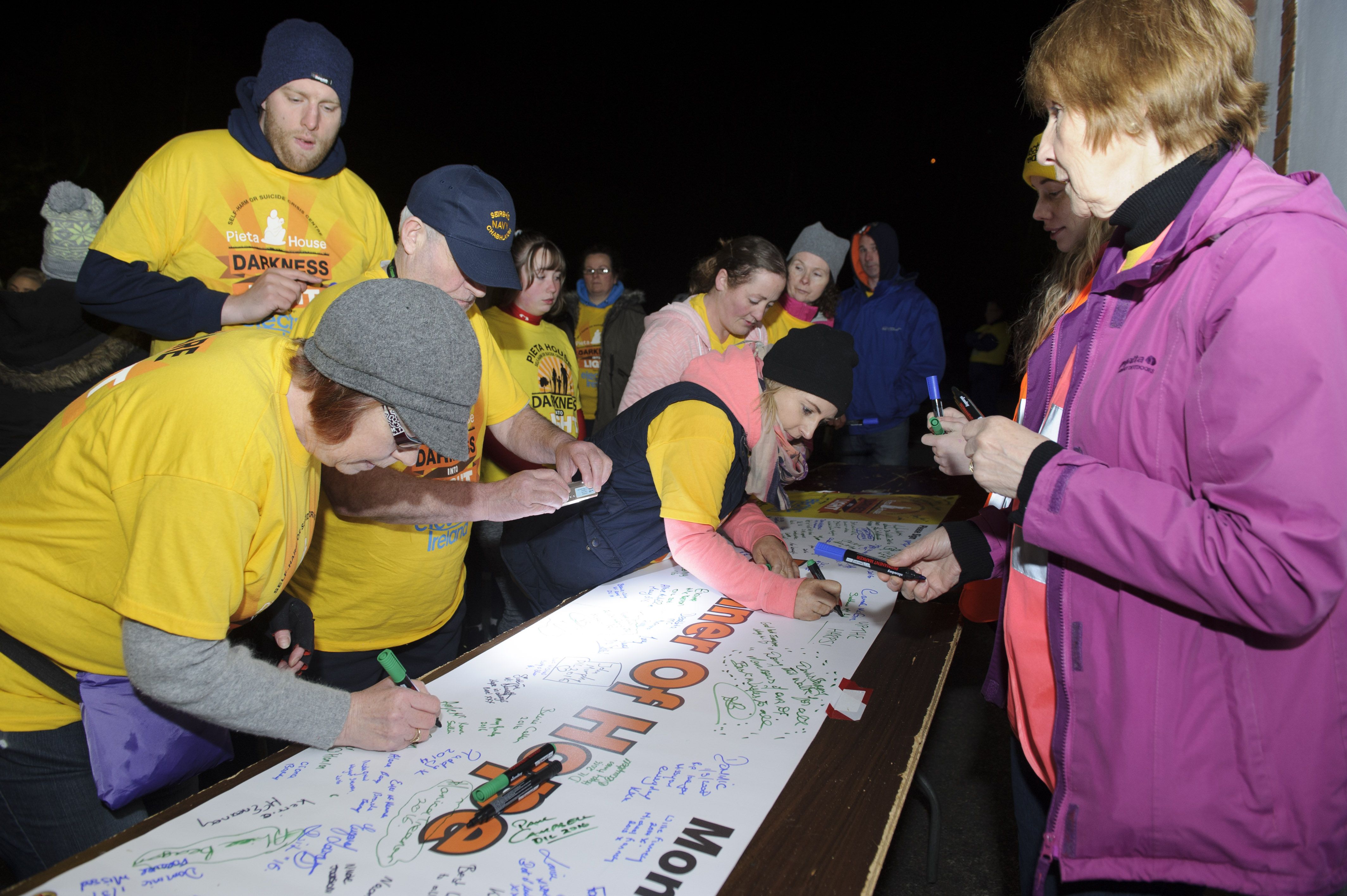 Some of the runners at the Monaghan Darkness Into Light signing a banner at the event. ©Rory Geary/The Northern Standard