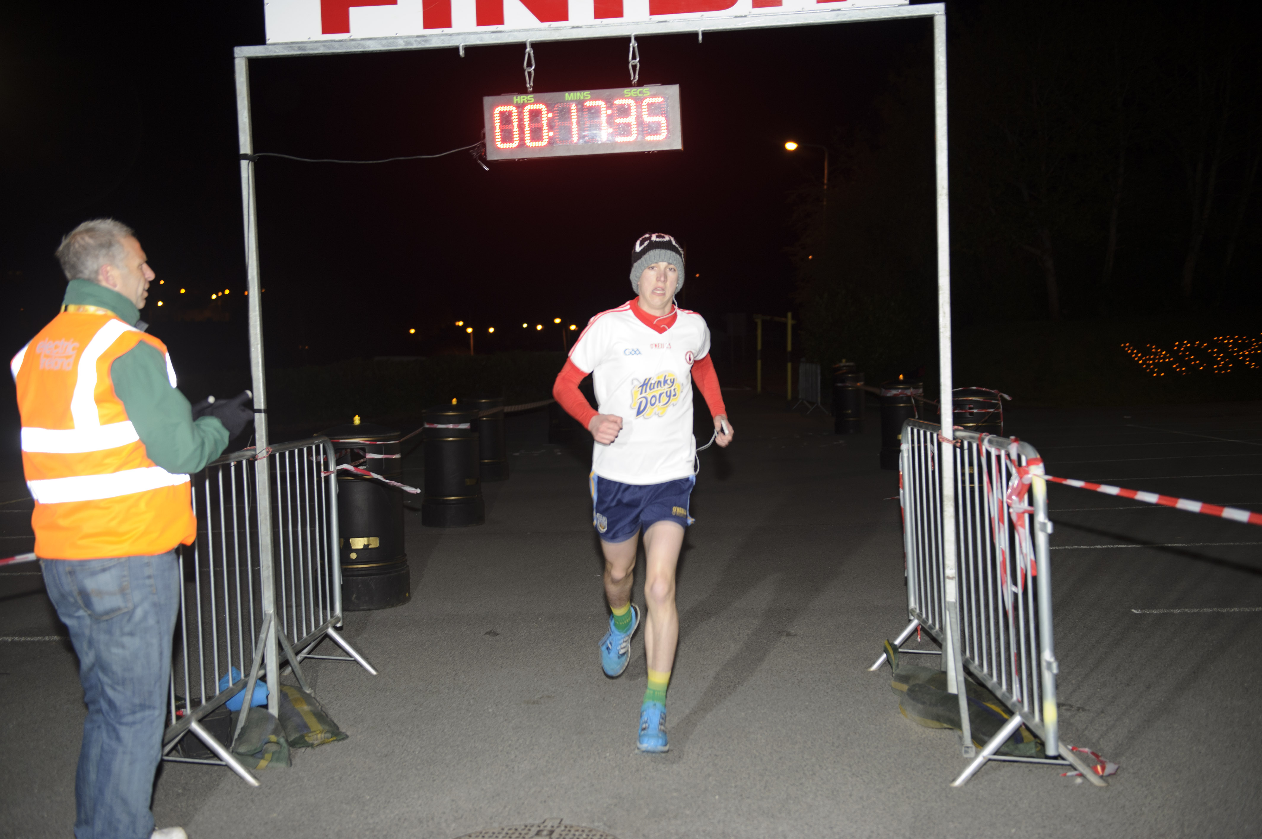Anthony O'Brien, winner, crossing the finish-line of the Darkness Into Light 5k. ©Rory Geary/The Northern Standard