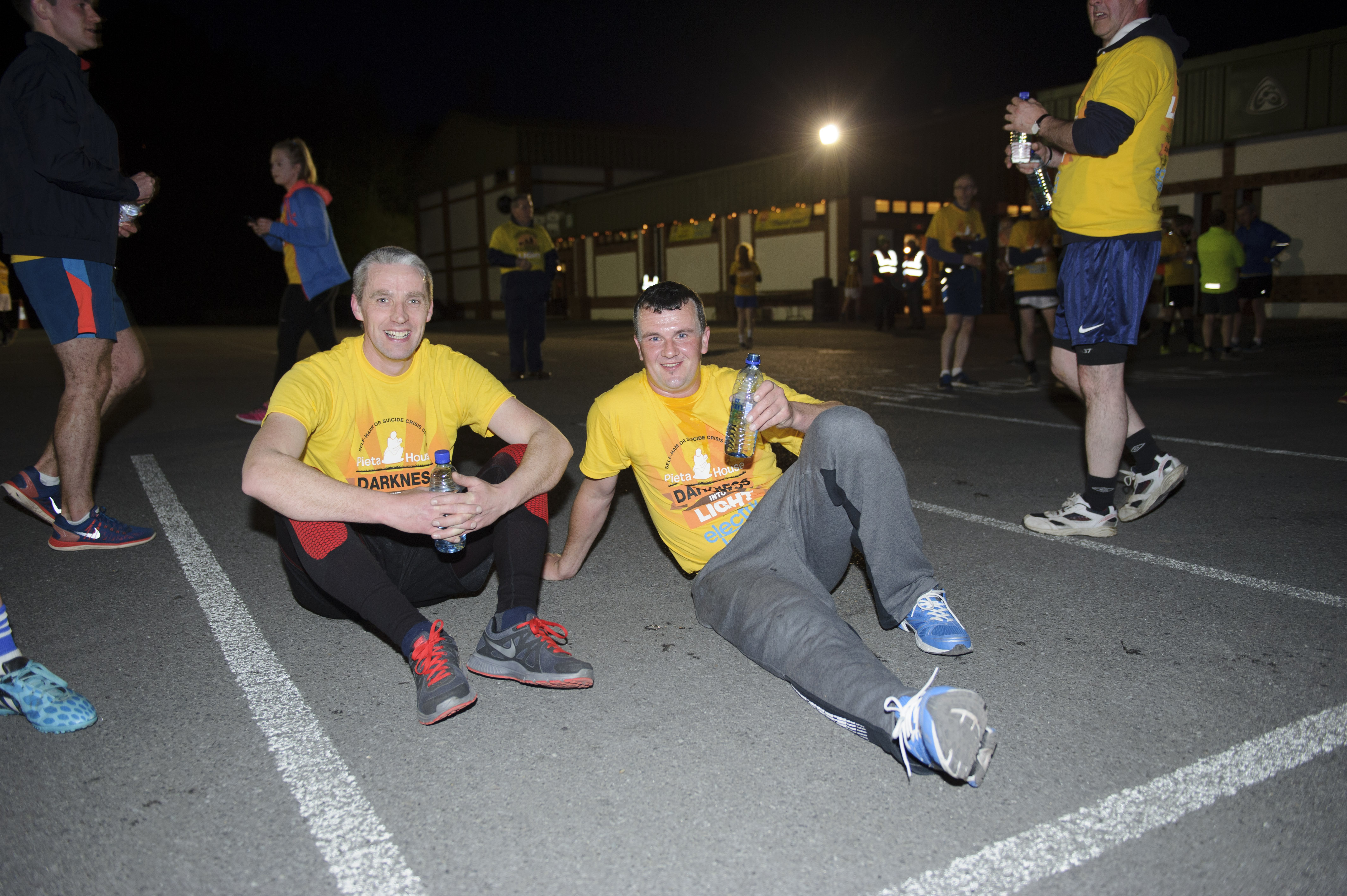 Paul Sherry and Mark Treanor, taking a rest after finishing the Darkness Into Light 5k for Pieta House. ©Rory Geary/The Northern Standard