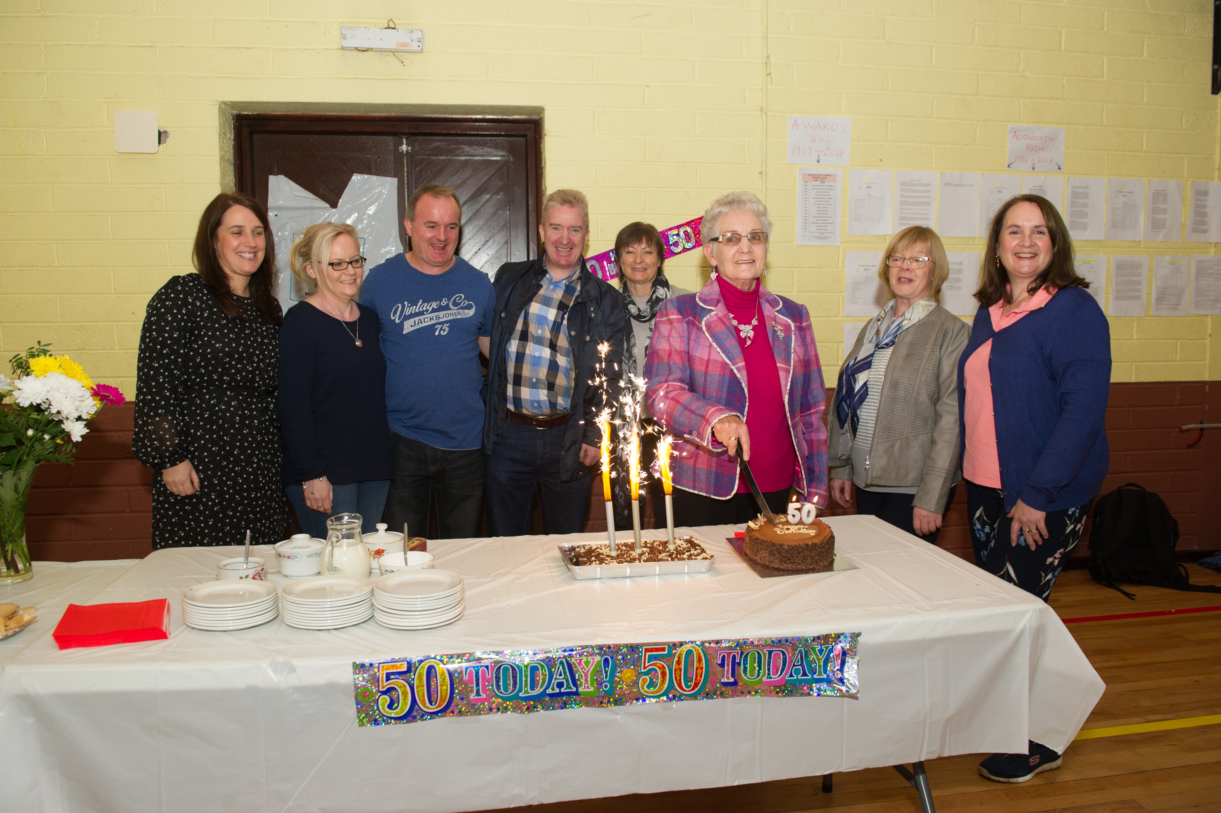 Angela McCaffrey cutting a cake at the Emyvale Tidy Town's 50th anniversary celebrations last Sunday. Included in the photo are (L-R) Patrica Ryan, Karen Fields, Enda Fields, John Finn, chairman, Bernie O'Flagherty, Waters & Communities Office, Angela McCaffrey, Norah Ryan and Mary Flynn. ©Rory Geary/The Northern Standard