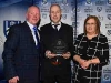Sean Walsh receives his Award for Scór and Culture from Cathal Smyth and Breda McCooey. © Northern Standard