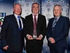 Garreth Coyle receives his Retirement Award from Cathal Smyth (Northern Standard) and Michael Owen McMahon (Co. Board Chairman) © Northern Standard