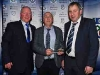 Cathal Smyth and Padraig Sherry present Anthony McKenna with his Special Merit Award. © Northern Standard