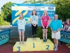 The winners of the 11-12 Girls Front Crawl, with Norman Griffin. ©Rory Geary/The Northern Standard