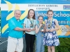 Norman Griffin, Monaghan Leisure Complex, making the presentation of the Best Girl Award at the Inter-Schools Gala to joint winners (L-R) Susie O'Flagherty, Emma Sherlock and Ava Kelly. ©Rory Geary/The Northern Standard