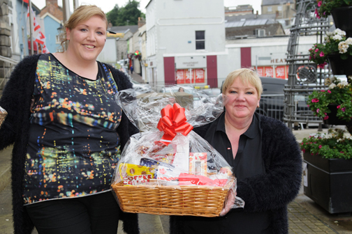 Winner of the 1st prize in the Monaghan Canada Day celebrations raffle, Brenda Clerkin, right, being presented by Ashling Clerkin. ©Rory Geary/The Northern Standard