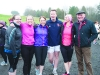 Martin Chambers, centre, with member of the Monroe family at the Monaghan Phoenix AC Goal Mile on St Stephen's Day. ©Rory Geary/The Northern Standard