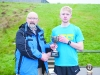 Winner of the Monaghan Phoenix AC Goal Mile, Paul Peppard, right, being presented with the Fiona Kieran Memorial Cup by Macartan Kieran. ©Rory Geary/The Northern Standard