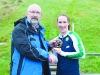 Ladies winner of the Monaghan Phoenix AC Goal Mile, Deirbhle Duffy, being presented with her award by Macartan Kieran. ©Rory Geary/The Northern Standard