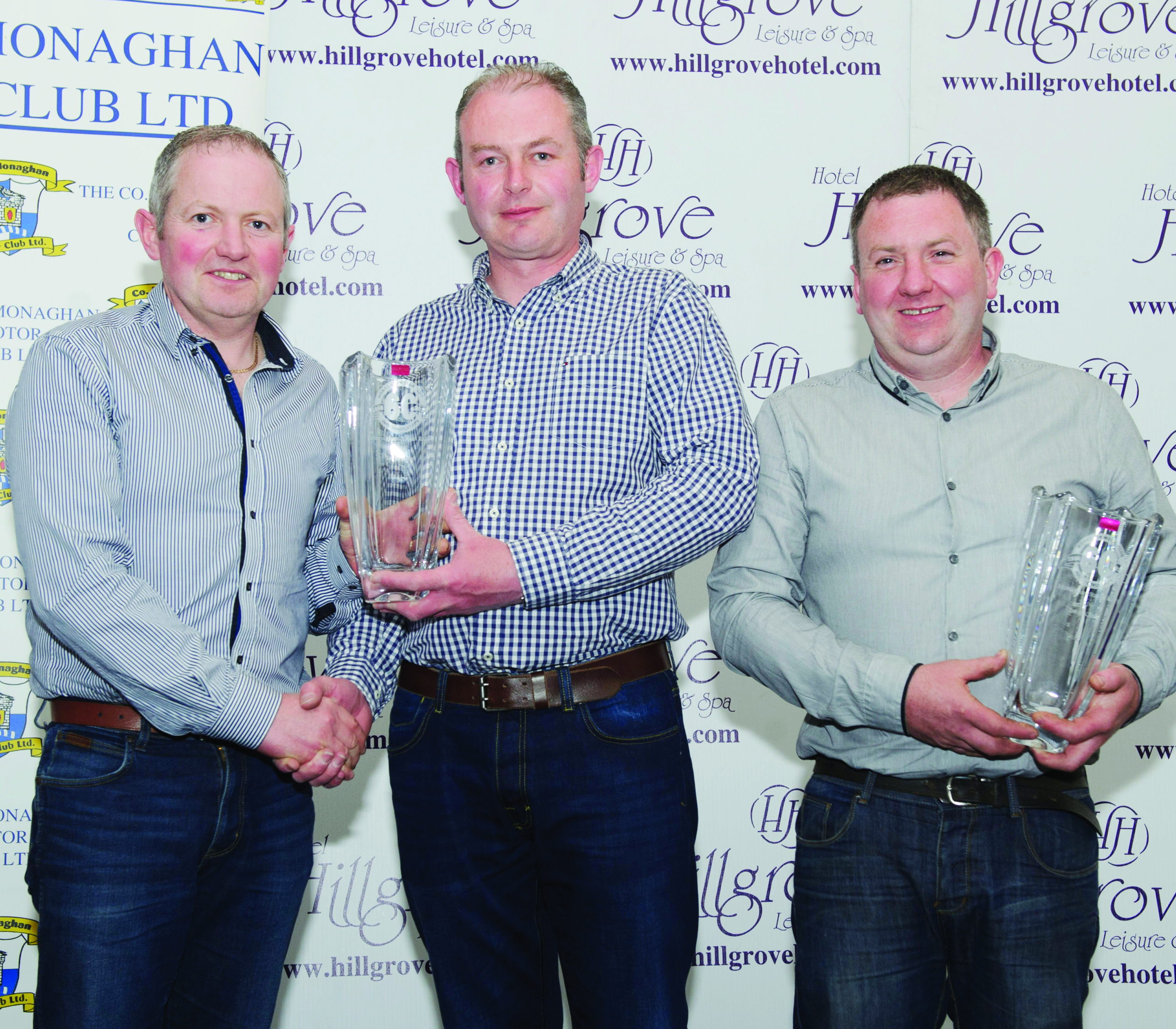 Diarmuid Leane, centre, making the presentation to winners of Class 10, John Kelly, left and Niall Kelly. ©Rory Geary/The Northern Standard