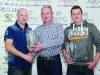 Diarmuid Leane, left, making the presentation winners of Class 11R, Seamus Connolly, left and Gary McCrudden. ©Rory Geary/The Northern Standard