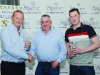 Thomas Treanor, centre, presenting Robert Moffett, left and Niall Tierney, with their awards for 3rd in Class 5. ©Rory Geary/The Northern Standard