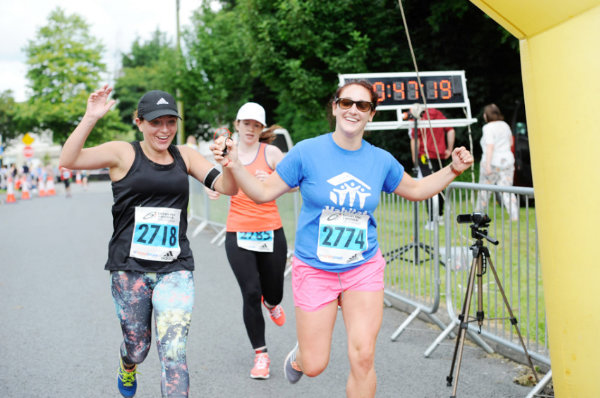 Danielle Corrigan and Laura McCann, crossing the finishline of the 5 Mile race together. ©Rory Geary/The Northern Standard