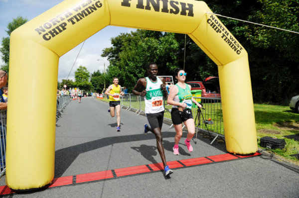 Winner of the Monaghan 10 Miler, Freddie Sittuk, Raheny, crossing the finishline, just ahead of Conor Duffy, Glaslough Harriers. ©Rory Geary/The Northern Standard