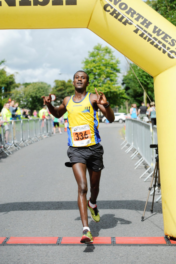 Eskander Turki from Monaghan Town Runners, crossing the finishline in 3rd place. ©Rory Geary/The Northern Standard