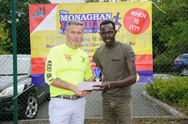 Colm Mahoney, left, Monaghan Town Runners, making the presentation to Freddie Sittuk, winner of the Monaghan 10 Miler. ©Rory Geary/The Northern Standard
