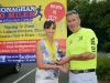 Colm Mahoney, Monaghan Town Runners, making the presentation to Patrica Brown, runner-up in the Ladies 5 Mile Race. ©Rory Geary/The Northern Standard