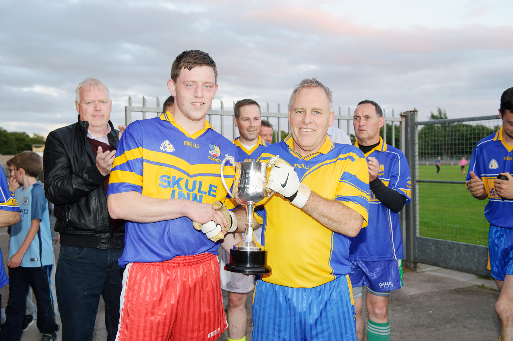 Niall Boylan, left, making the presentation of The Ned Boylan Cup for the recreational football final to Gerry Reilly, captain of the Eire Óg team, that won the final. ©Rory Geary/The Northern Standard