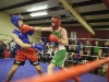Mathew Murnion, St Branagh's, landing a right to his opponent Billy McGuinness from England, during the Old School Boxing Club tournament in The Skule Inn. ©Rory Geary/The Northern Standard