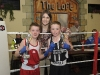Niall Smyth, left, Old School Boxing Club  and D Sherry from Emyvale Boxing Club, with Katie Taylor, after their bout at last weekend's tournament. ©Rory Geary/The Northern Standard