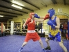 Aaron McKenna, left, Old School Boxing Club, Smithboro and Josh Quinn, England, exchanging punches, during their bout at the tournament last weekend. ©Rory Geary/The Northern Standard