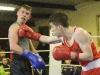 Gary McKenna, Old School Boxing Club, landing a right to Steve Eilbeck, left, England, in action during their bout at the Old School Boxing Club tournament in The Skule Inn. ©Rory Geary/The Northern Standard