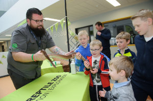 Jimmy from Dublin Zoo, showing some of the attendance at the science festival fun day a Rainbow Boa snake.