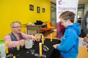 Declan McGeown from the Royal Society of Chemistry, showing Finn Connolly an experiment at the funday last Saturday. ©Rory Geary/The Northern Standard