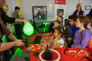 Some of the children at the science festival funday watching an experiment with lazers during the day. ©Rory Geary/The Northern Standard