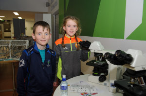 Orán and Niamh McCarville at the science festival funday with some microscopes showing marine life. ©Rory Geary/The Northern Standard