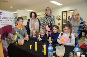 A group of children and mothers, taking part in experiments at the Royal Society of Chemistry stand at the funday. ©Rory Geary/The Northern Standard